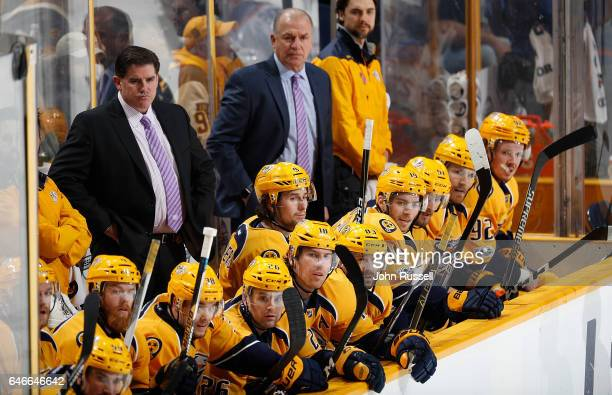 Head coach Peter Laviolette of the Nashville Predators watches the play against the Edmonton Oilers during an NHL game at Bridgestone Arena on...