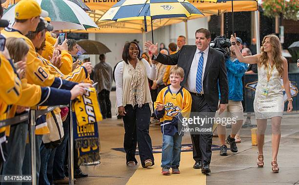 Head coach Peter Laviolette of the Nashville Predators waves to fans as he arrives for an NHL game against Chicago Blackhawks at Bridgestone Arena on...