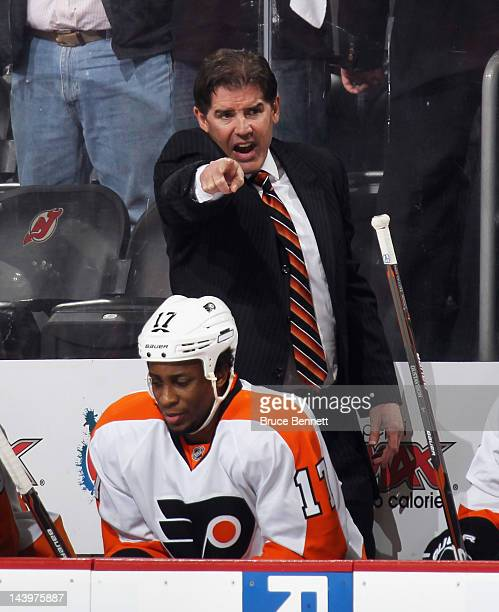 Head coach Peter Laviolette of the Philadelphia Flyers gives players instructions in the closing minute of play against the New Jersey Devils in Game...