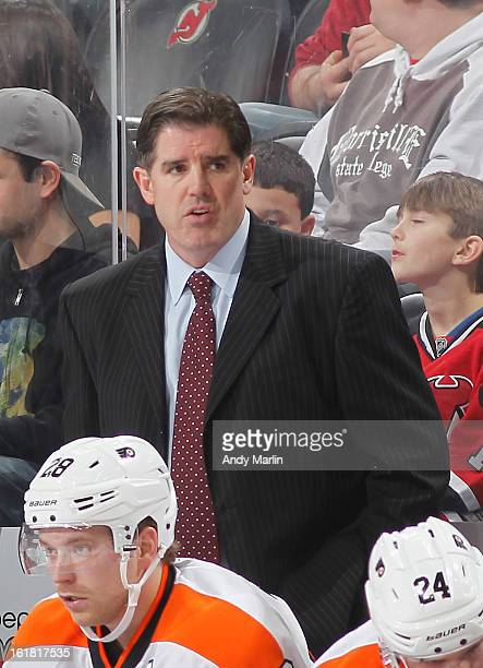 Head coach Peter Laviolette of the Philadelphia Flyers looks on against the New Jersey Devils at the Prudential Center on February 15 2013 in Newark...