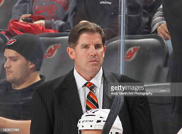 Head coach Peter Laviolette of the Philadelphia Flyers looks on against the New Jersey Devils during the preseason game at Prudential Center on...
