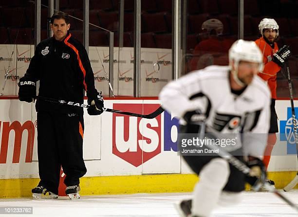 Head coach Peter Laviolette of the Philadelphia Flyers watches his team during Stanley Cup practice at the United Center on May 28 2010 in Chicago...