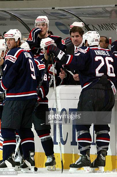 Head coach, Peter Laviolette, of the USA, talks to his teammate during a time out in the third period against Finland in the IIHF World Men's...