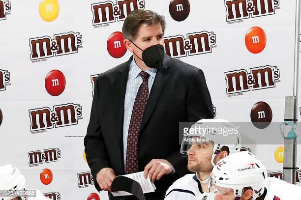Head coach Peter Laviolette of the Washington Capitals looks on during the second period against the New Jersey Devils at Prudential Center on...
