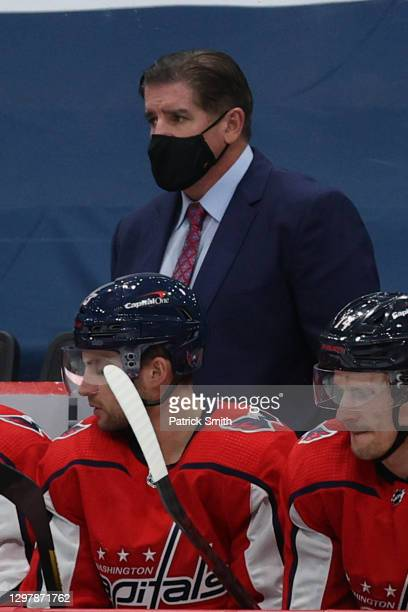 Head coach Peter Laviolette of the Washington Capitals looks on against the Buffalo Sabres during the first period at Capital One Arena on January...