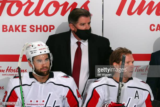 Head coach Peter Laviolette of the Washington Capitals watches the action between Tom Wilson and Nicklas Backstrom during an NHL game against the...