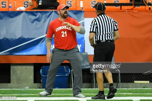 Head coach Peter Milliman of the Cornell Big Red reacts to a call with an official against the Syracuse Orange during a 2018 NCAA Division I Men's...