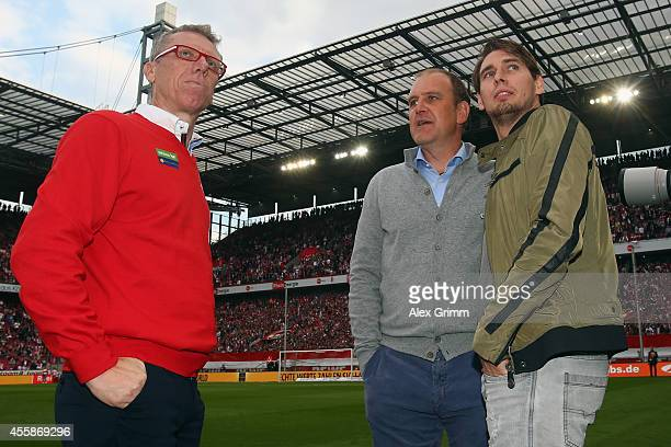 Head coach Peter Stoeger manager Joerg Schmadtke and Patrick Helmes of Koeln stand together prior to the Bundesliga match between 1 FC Koeln and...