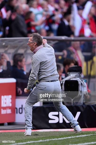 Head coach Peter Stoeger of 1 FC Koeln celebrates after the final whistle during the Bundesliga match between 1 FC Koeln and 1899 Hoffenheim at...