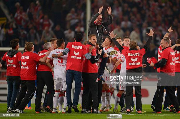 Head coach Peter Stoeger of 1 FC Koeln celebrates with his team during the Second Bundesliga match between 1 FC Koeln and VfL Bochum at...