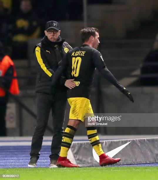 Head coach Peter Stoeger of Borussia Dortmund substitutes Mario Goetze of Borussia Dortmund during the Bundesliga match between Hertha BSC and...