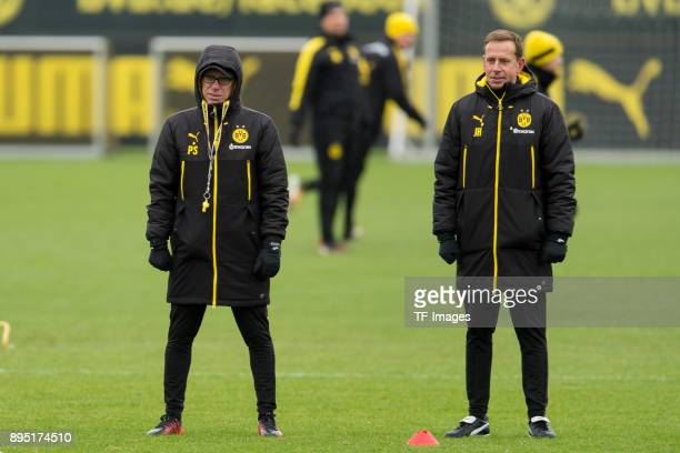 Head coach Peter Stoeger of Dortmund and Assistant coach Joerg Heinrich of Dortmund look on during a training session at BVB trainings center on...