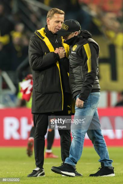 Head coach Peter Stoeger of Dortmund and Cocoach Joerg Heinrich of Dortmund celebrate after winning the Bundesliga match between 1 FSV Mainz 05 and...