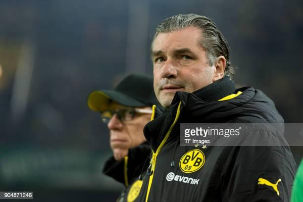 Head coach Peter Stoeger of Dortmund and Michael Zorc of Dortmund looks on prior the Bundesliga match between Borussia Dortmund and VfL Wolfsburg at...
