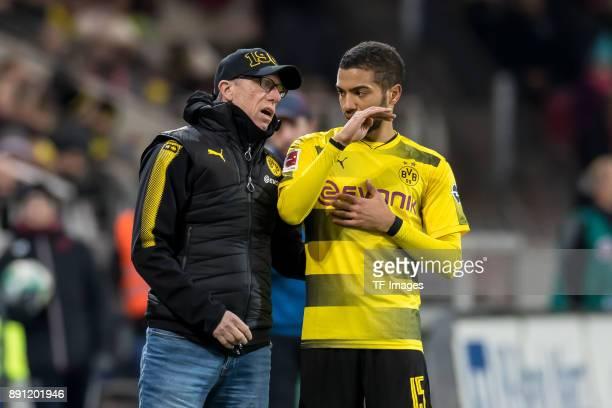 Head coach Peter Stoeger of Dortmund speaks with Jeremy Toljan of Dortmund during the Bundesliga match between 1 FSV Mainz 05 and Borussia Dortmund...