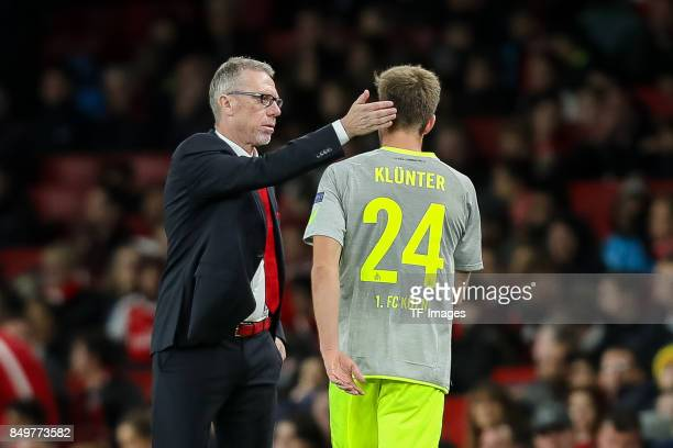 Head coach Peter Stoeger of FC Koeln speak with Lukas Kluenter of FC Koeln during the UEFA Europa League group H match between Arsenal FC and 1 FC...
