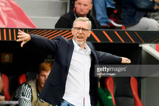 Head coach Peter Stoeger of Ferencvarosi TC gestures during the UEFA Europa League group G match between Bayer Leverkusen and Ferencvarosi TC at...