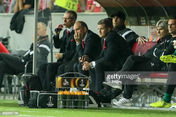 Head coach Peter Stoeger of Koeln and Joerg Schmadtke of Koeln looks on during the UEFA Europa League group H match between 1 FC Koeln and Crvena...