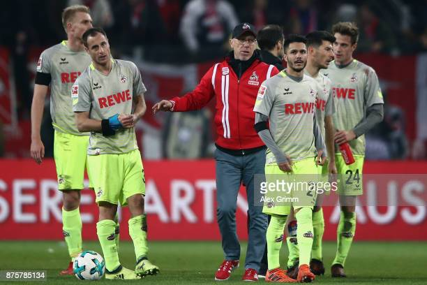 Head coach Peter Stoeger of Koeln comforts his players after the Bundesliga match between 1 FSV Mainz 05 and 1 FC Koeln at Opel Arena on November 18...