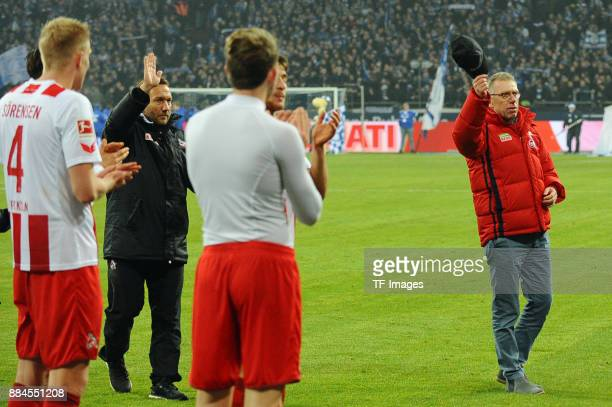 Head coach Peter Stoeger of Koeln gestures and players of Koeln applaud him after the Bundesliga match between FC Schalke 04 and 1 FC Koeln...