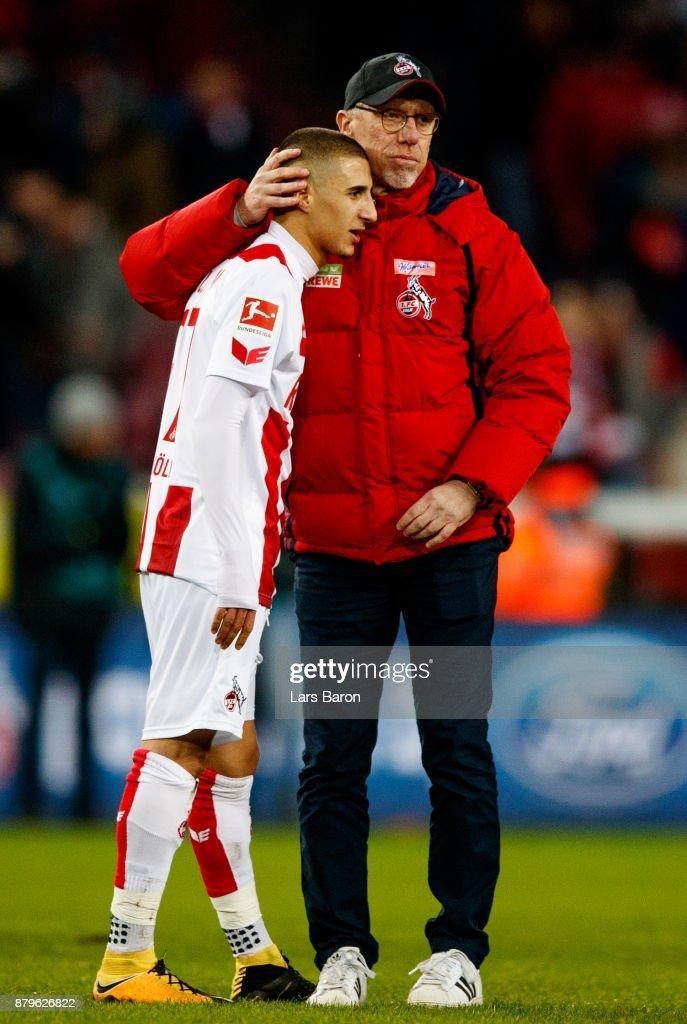 Head coach Peter Stoeger of Koeln hughs Anas Ouahim after loosing the Bundesliga match between 1. FC Koeln and Hertha BSC at RheinEnergieStadion on November 26, 2017 in Cologne, Germany.