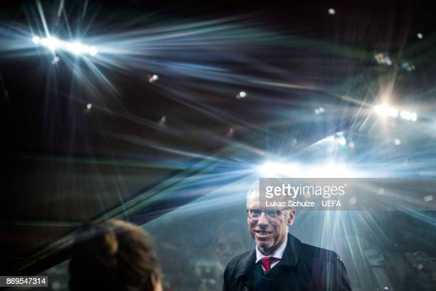 Head Coach Peter Stoeger of Koeln is seen through glass prior to the UEFA Europa League group H match between 1 FC Koeln and BATE Borisov at...