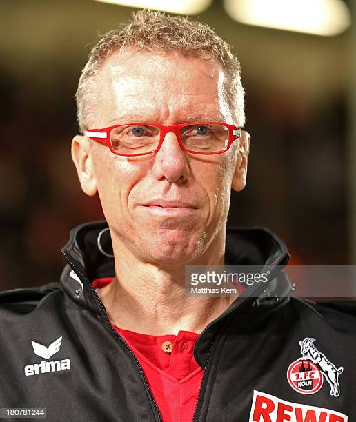 Head coach Peter Stoeger of Koeln looks on prior to the Second Bundesliga match between FC Energie Cottbus and 1.FC Koeln at Stadion der Freundschaft...