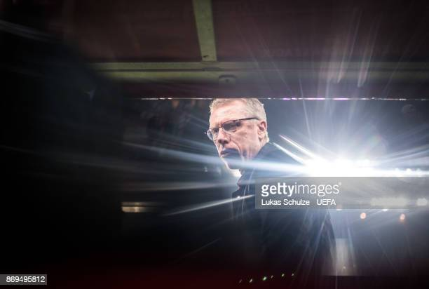 Head Coach Peter Stoeger of Koeln looks up prior to the UEFA Europa League group H match between 1 FC Koeln and BATE Borisov at RheinEnergieStadion...