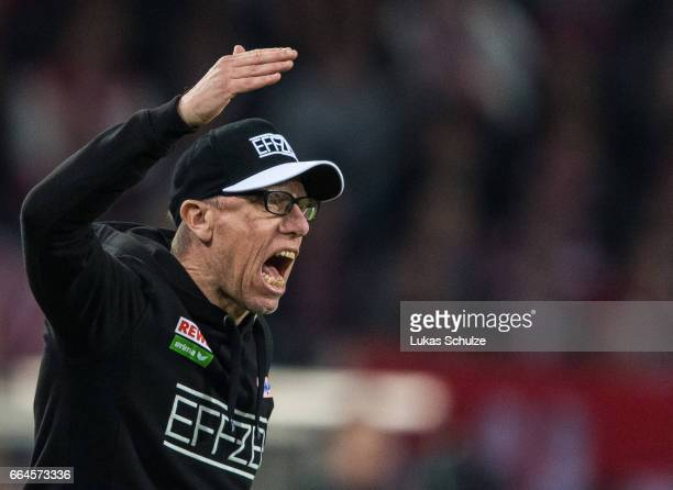 Head Coach Peter Stoeger of Koeln reacts on the side line during the Bundesliga match between 1 FC Koeln and Eintracht Frankfurt at...