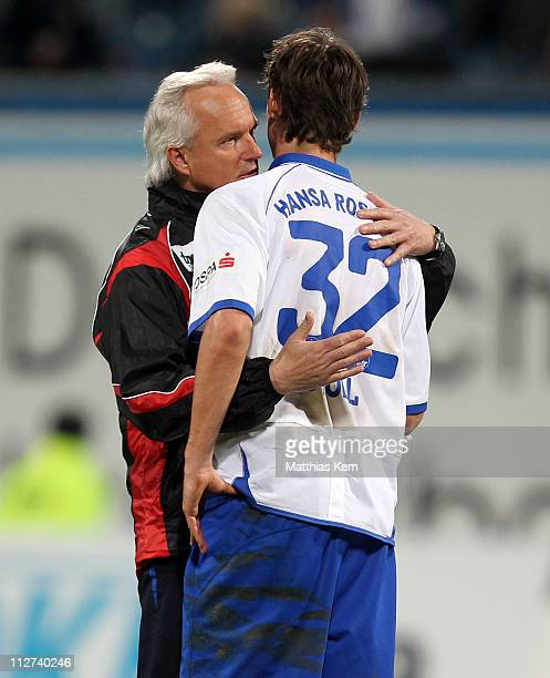 Head coach Peter Vollmann of Rostock and Martin Stoll console each other after losing the Third League match between FC Hansa Rostock and SV...