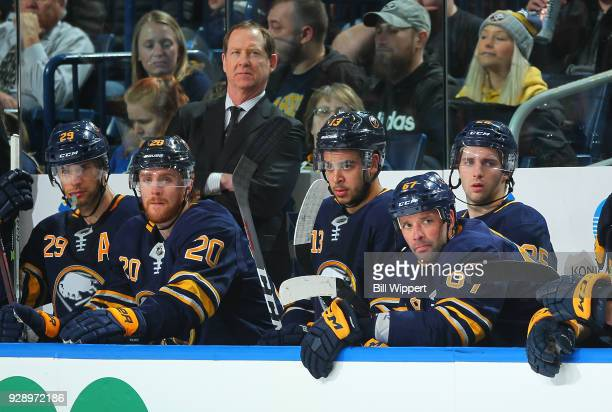 Head coach Phil Housley and Buffalo Sabres players follow the play during an NHL game against the Calgary Flames on March 7 2018 at KeyBank Center in...