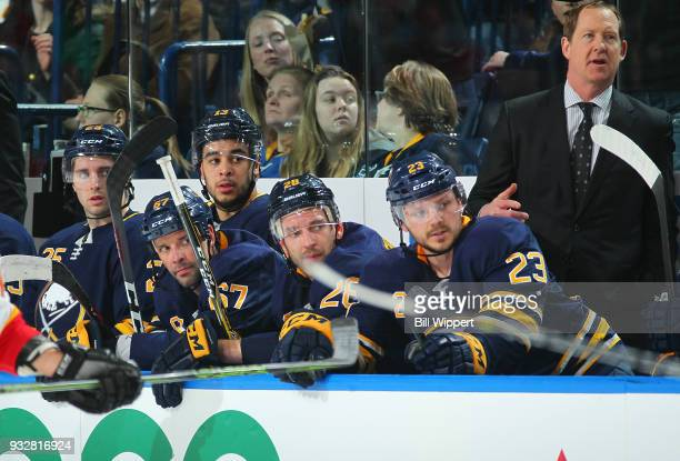 Head coach Phil Housley and Buffalo Sabres players watch the action during an NHL game against the Calgary Flames on March 7 2018 at KeyBank Center...