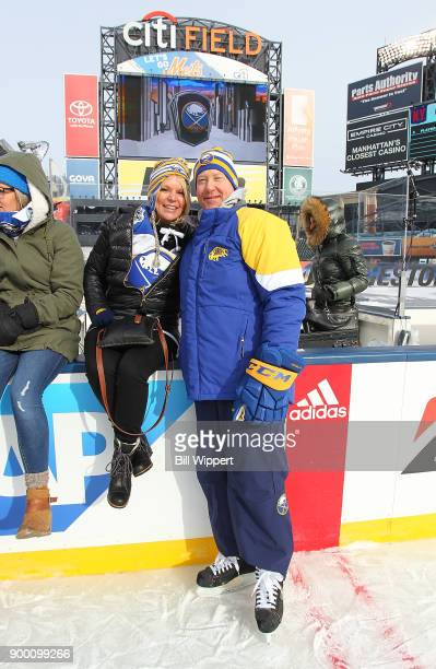 Head coach Phil Housley of the Buffalo Sabres poses with his wife Karin at Practice Day for the 2018 Bridgestone NHL Winter Classic at Citi Field on...
