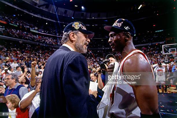 Head coach Phil Jackson and Michael Jordan of the Chicago Bulls celebrate after defeating the Utah Jazz in Game six of the 1997 NBA Finals at the...