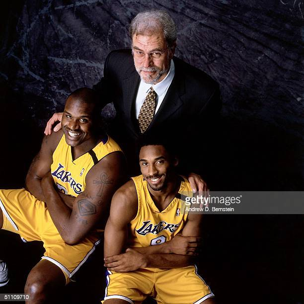 Head Coach Phil Jackson center Shaquille O'Neal and Kobe Bryant of the Los Angeles Lakers pose for a portrait at the Staples Center circa 2000 in Los...