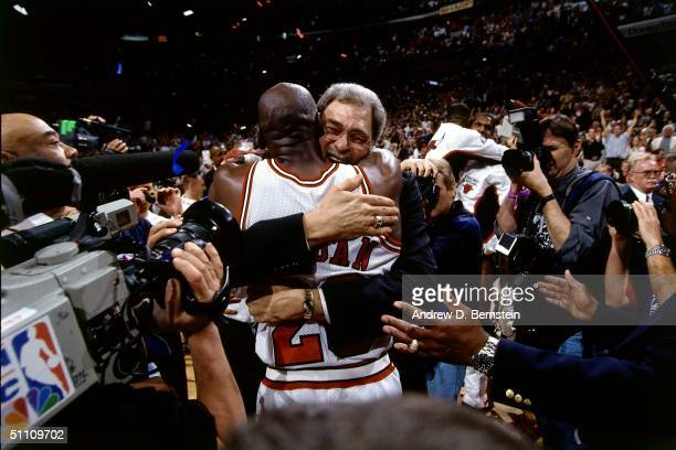 Head Coach Phil Jackson hugs Michael Jordan of the Chicago Bulls after the game circa 1997 at the United Center in Chicago, Illinois. NOTE TO USER:...
