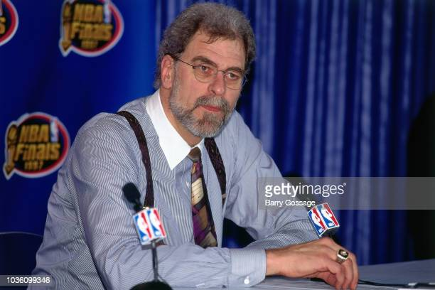 Head Coach Phil Jackson of the Chicago Bulls talks with media at the post game interview after the game against the Utah Jazz on June 8 1997 at the...