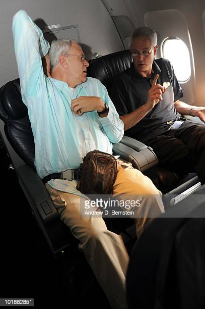 Head coach Phil Jackson of the Los Angeles Lakers and general manager Mitch Kupchak relax on the team plane to Boston for Game Three of the 2010 NBA...