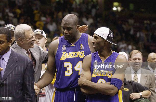 Head coach Phil Jackson of the Los Angeles Lakers congratulates Shaquille O'Neal and Kobe Bryant of the Lakers after defeating the New Jersey Nets in...