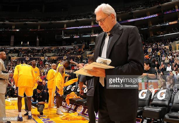 Head coach Phil Jackson of the Los Angeles Lakers draws up a play before the game against the Memphis Grizzlies on November 6 2009 at Staples Center...