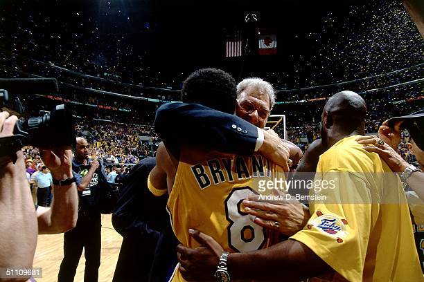 Head Coach Phil Jackson of the Los Angeles Lakers hugs Kobe Bryant of the Los Angeles Lakers after winning the 2000 NBA Championship circa 2000 at...
