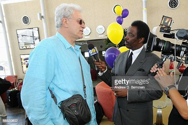 Head coach Phil Jackson of the Los Angeles Lakers is interviewed by Jim Hill after arriving at LAX on June 15 2009 in Los Angeles California after...