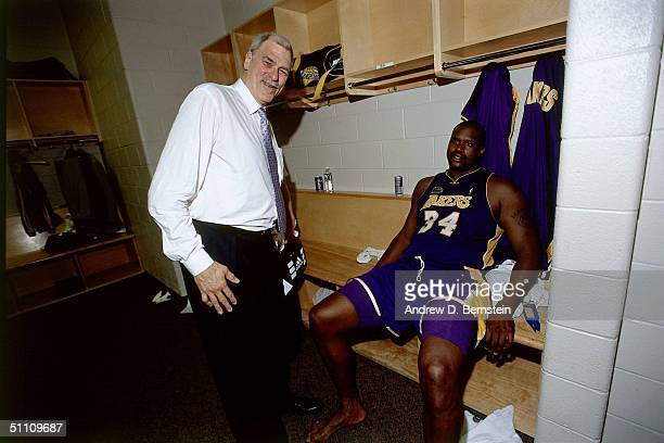 Head Coach Phil Jackson of the Los Angeles Lakers looks on from the locker room with Shaquille O'Neal of the Los Angeles Lakers circa 2001 at the...