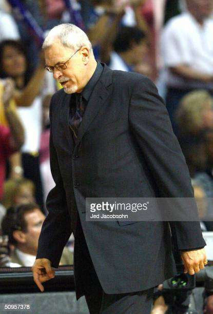 Head coach Phil Jackson of the Los Angeles Lakers walks along the sideline in the first quarter of game four of the 2004 NBA Finals against the...
