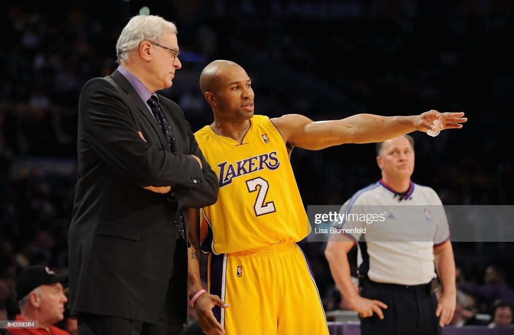 Head coach Phil Jackson talks with Derek Fisher #2 of the Los Angeles Lakers during the game against the Phoenix Suns at at Staples Center on December 10, 2008 in Los Angeles, California.