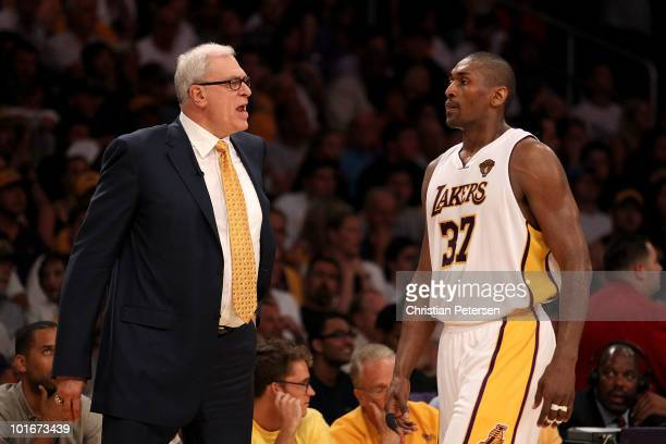 Head coach Phil Jackson yells at Ron Artest of the Los Angeles Lakers in the second half against the Boston Celtics in Game Two of the 2010 NBA...
