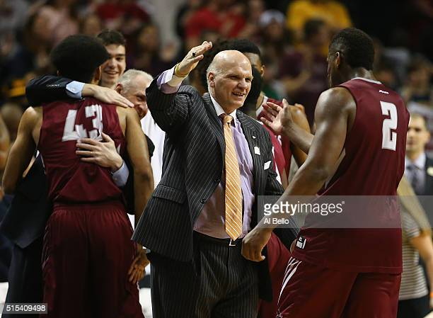 Head coach Phil Martelli of the Saint Joseph's Hawks celebrates with Aaron Brown after defeating Virginia Commonwealth Rams for Atlantic 10...