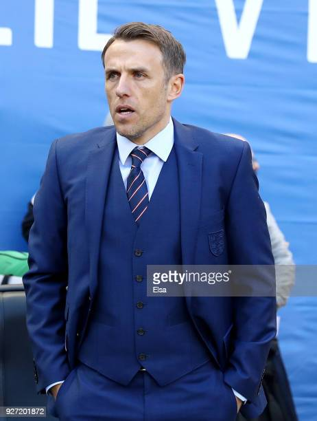 Head coach Phil Neville of England looks on from the bench in the before the game against Germany during the SheBelieves Cup at Red Bull Arena on...