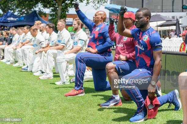 Head Coach Phil Simmons of the West Indies and captain Kane Williamson of New Zealand and his team mates take a knee in support of the Black Lives...