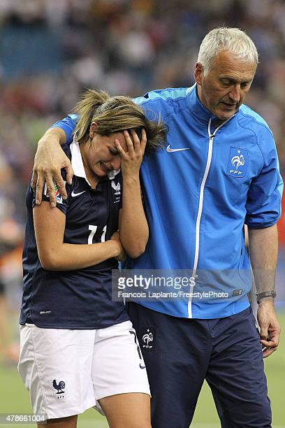 Head coach Philippe Bergeroo consoles Claire Lavogez of France after losing against Germany during the FIFA Women's World Cup Canada 2015 quarter...